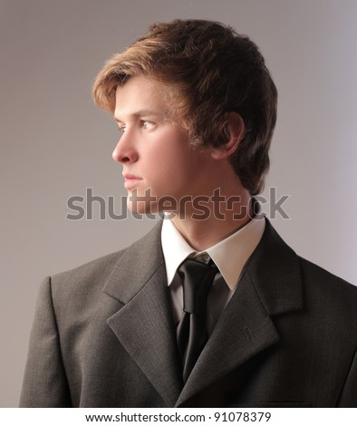 Profile of a young businessman - stock photo