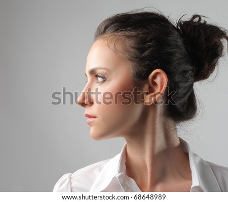Profile of a young businesswoman - stock photo