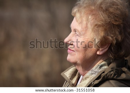 Profile of aged woman - stock photo