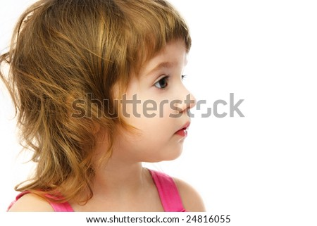 profile of an adorable caucasian girl with curly hair, against white background - stock photo