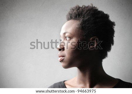 Profile of an african woman - stock photo