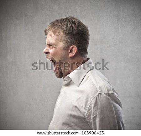 Profile of an angry man shouting - stock photo