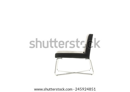 Profile of an elegant modern black chair in a simple classic design with crossed metal legs isolated on white with copyspace - stock photo