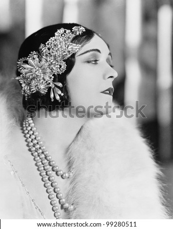 Profile of an elegant woman wearing a jeweled hair piece - stock photo