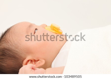 Profile of Asian boys to make pacifier
