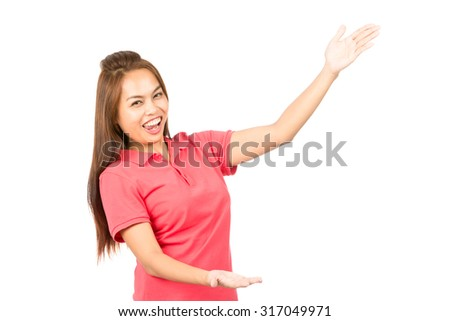 Profile of Asian female, casual clothes, hands, arms out to side, body language presenting, displaying product or person while looking at camera with huge toothy smile. Horizontal - stock photo
