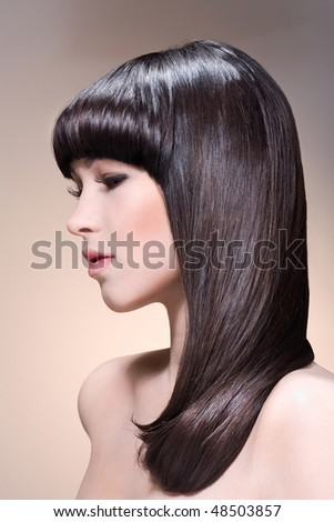 Profile of Beautiful charming woman with straight long hair professionally done. - stock photo