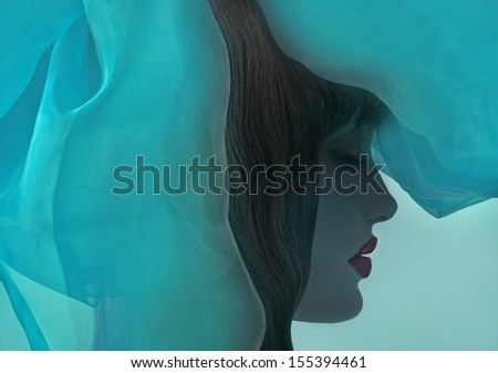 profile of beautiful girl with fantasy drapery.  - stock photo