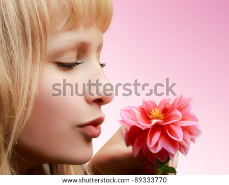 Profile of beautiful girl with flower on pink background - stock photo