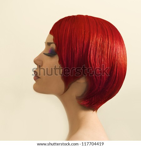 profile of beautiful girl with short red hair - stock photo