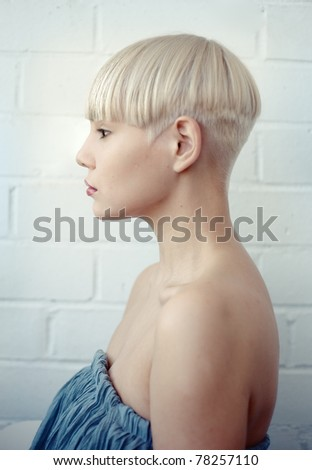 profile of beautiful young woman over white background (DOF effect) - stock photo