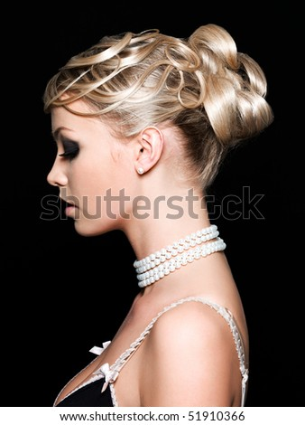 Profile of beautiful young woman with fashion hairstyle - stock photo