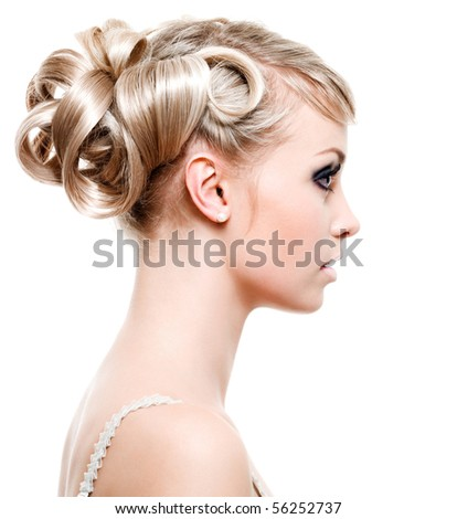 Profile of beautiful young woman with fashion hairstyle - on white background - stock photo