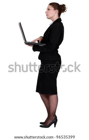 Profile of brunette holding laptop - stock photo
