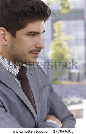 Profile of confident young elegant businessman smiling. - stock photo