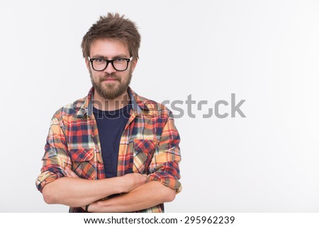 Profile of cute bearded man with his arms crossed. Short-haired man in glasses smiling isolated on white background. - stock photo