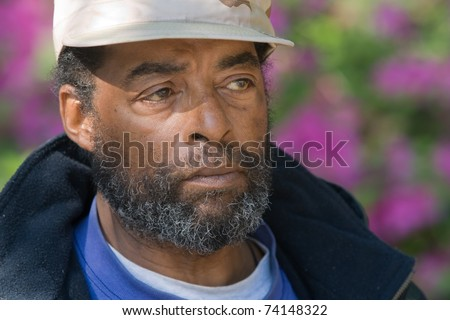 Profile of elderly African American man outdoors - stock photo