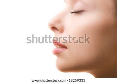 Profile of feminine face with closed eyes and make-up - stock photo