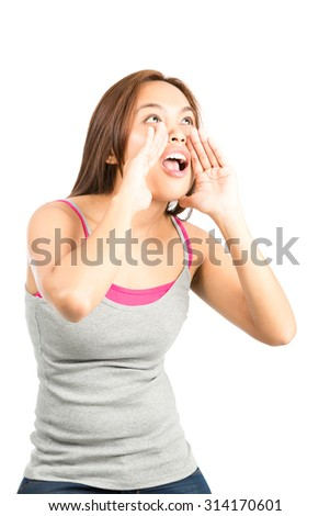 Profile of gorgeous Asian female in sleeveless tank top, looking up and away cupping hands around her mouth to shout, scream, announce something