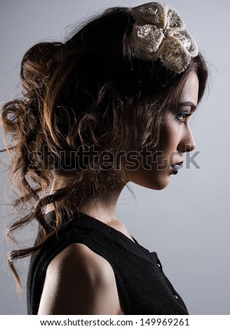 Profile of gorgeous young lady - stock photo