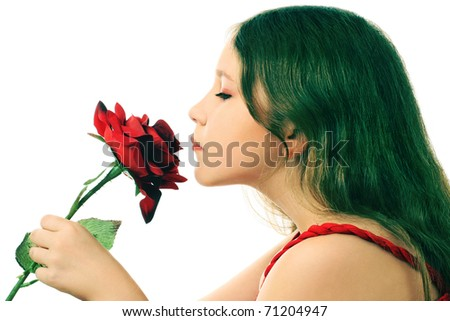 Profile of inspired girl child with flower isolated on white background - stock photo