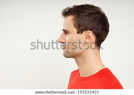 Profile of man in red shirt - stock photo
