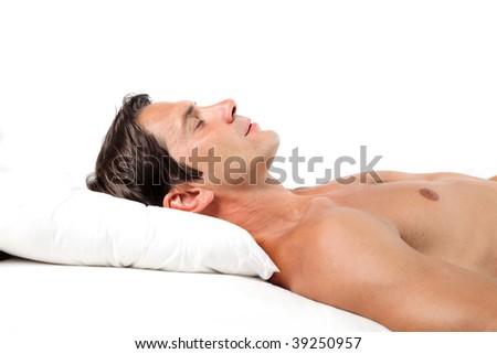 profile of man sleeping on white pillow - stock photo