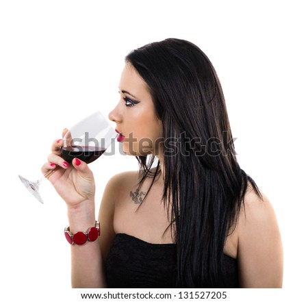 Profile of pretty girl with black dress drinking red wine, isolated on white - stock photo