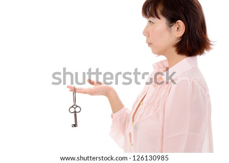 Profile of sexy asian woman holding a antique key