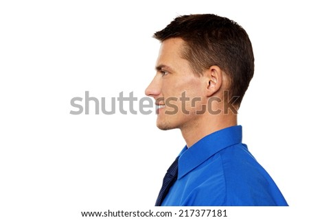 Profile of smiling young man in blue shirt and tie - stock photo