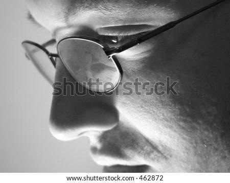 Profile of Studious Man in Glasses - stock photo