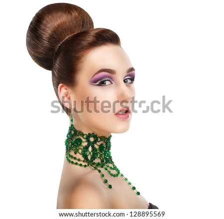 Profile of Stylish Woman with Green Gems. Luxury. Aristocratic Profile - stock photo