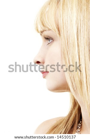 Profile of the face of a beautiful blonde woman with blue eyes and pink lips - stock photo