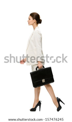 Profile of walking business woman with suitcase, isolated on white. Concept of leadership and success - stock photo