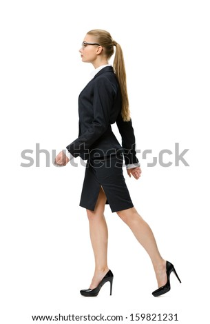 Profile of walking businesswoman, isolated on white. Concept of leadership and success - stock photo