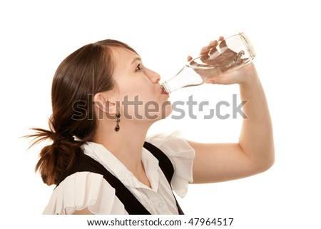 Profile of woman drinking water from a glass bottle - stock photo