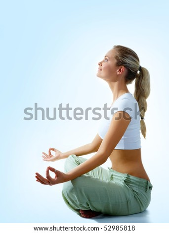 Profile of woman meditating in pose of lotus in isolation - stock photo