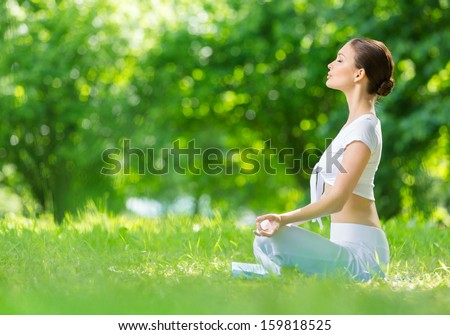 Profile of woman who sits in asana position zen gesturing. Concept of healthy lifestyle and relaxation