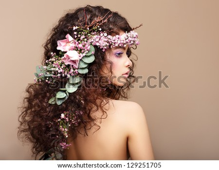 Profile of Woman with Colorful Wreath of Flowers. Valentine's Day - stock photo
