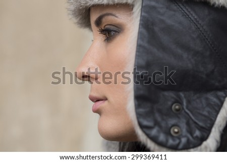 Profile of woman with hat - stock photo