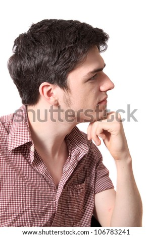 Profile of young man with his fist to chin as if thinking on a white background - stock photo