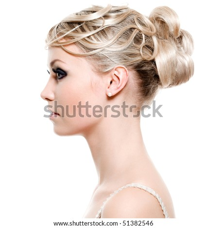 Profile of young woman with beauty fashion hairstyle - on white background - stock photo