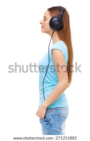 Profile of young woman with headphones listening to music - isolated on white background. - stock photo