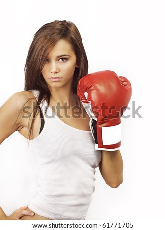 Profile photo of young woman wearing boxing glove