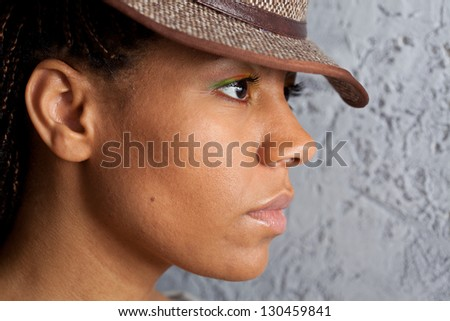 profile portrait of a black girl in hat - stock photo
