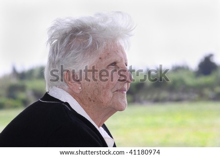 profile portrait of a caucasian old woman - stock photo
