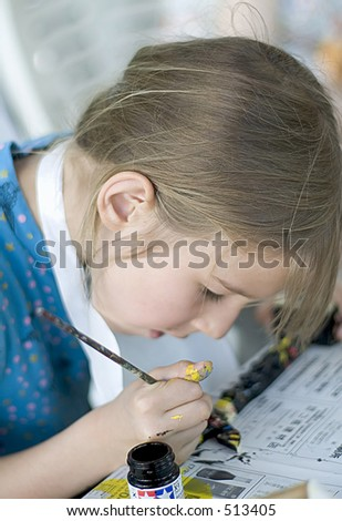 Profile portrait of a girl painting totem - stock photo