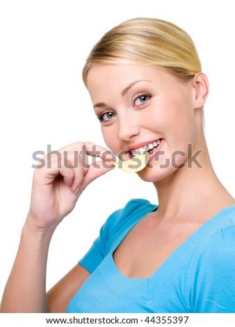 Profile Portrait of a happy beautiful woman eats the chips - over white background. Copy space - stock photo