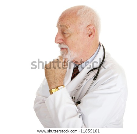 Profile portrait of a mature intelligent doctor.  Isolated on white. - stock photo