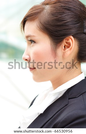 Profile portrait of attractive business woman